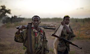 Somali National Army soldiers pose with their weapons