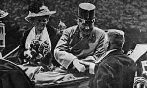 Franz Ferdinand riding in an open carriage shortly before his assassination.
