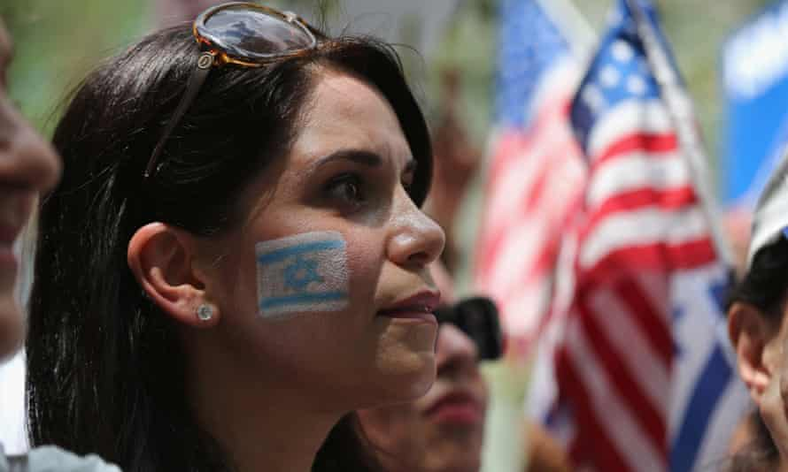 A woman takes part in a rally in support of Israel near the United Nations Headquarters in New York.