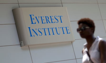 A person walking past an Everest Institute sign in a office building in Silver Spring, Md. Corinthian Colleges has agreed to close a dozen U.S. campuses in 11 states and place 85 up for sale. The company serves 72,000 students and owns Everest College, Heald College and WyoTech schools.
