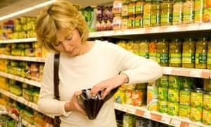 Woman opens purse in supermarket