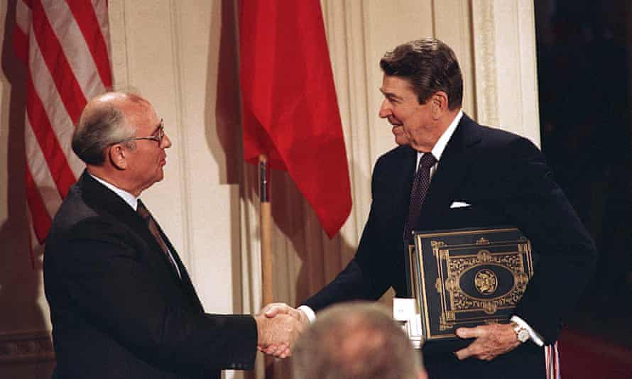 Ronald Reagan and Mikhail Gorbachev shake hands in 1987 after signing the Intermediate Range Nuclear Forces Treaty, which Russia is now accused of breaching by Washington.
