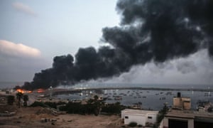 A building within the Gaza port on fire after Israeli bombardment.