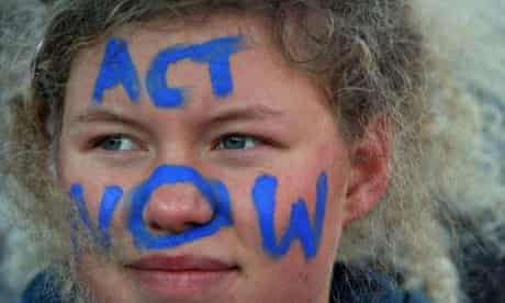 COPENHAGEN, DENMARK: A protestor with the painting 'Act now'