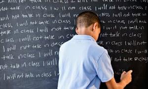 boy writing punishment