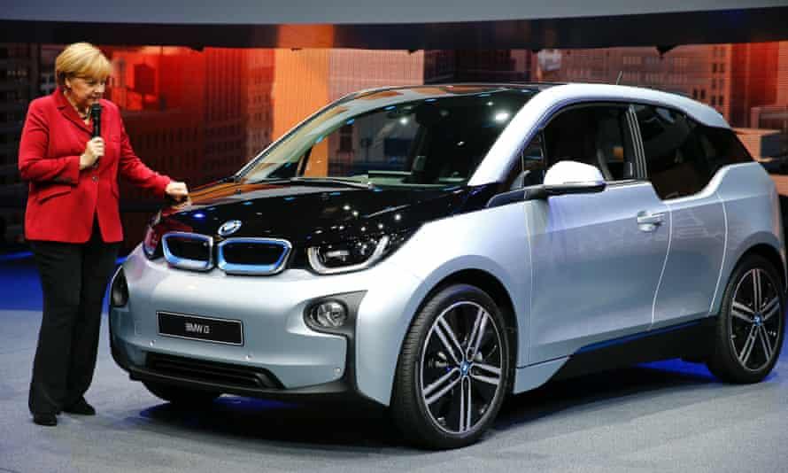 German chancellor Angela Merkel next to the new BMW i3 electric car