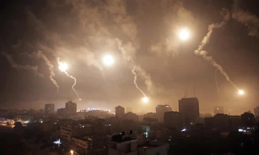 Israeli forces' flares light up the night sky of Gaza City early Tuesday