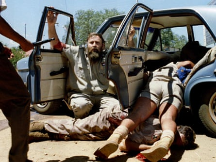 A member of South Africa's neo-Nazi Afrikaner Resistance Movement (AWB) begs for his life, Bophuthatswana, March 1994