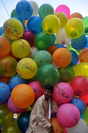 A man sells colourful balloons as he waits for customers in Karachi, Pakistan