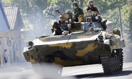 An armoured vehicle manned by pro-Russian rebels leaves Donetsk in the direction of the MH17 crash site