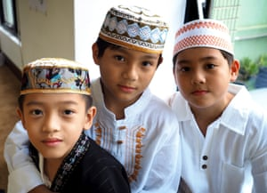 Young boys celebrate Eid-al-Fitr at the Taichung Mosque in Taichung City, Taiwan
