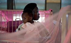 Mother and child in a malaria ward in Kiboga hospital, Uganda