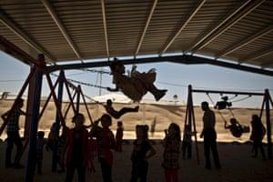 Syrian refugee children enjoy the second day of Eid al-Fitr at Zaatari refugee camp