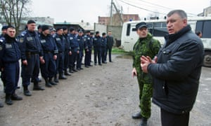 Igor Bezler, in green fatigues and without his walrus moustache, is at a briefing of policemen in Gorlovka.