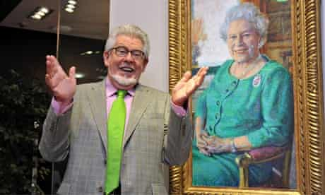 Rolf Harris with his painting of the the Queen