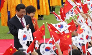 Chinese President Xi Jinping (R) and South Korean President Park Geun-Hye (L) at a welcoming ceremony at the presidential Blue House in Seoul on 3 July 2014. Photograph: Chung Sung-Jun/Pool/EPA