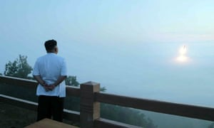 This undated picture released from North Korea's official Korean Central News Agency on 30 June, 2014 shows North Korean leader Kim Jong-Un (R) observing a tactical rocket launch by the Korean People's Army Strategic Force at an undisclosed place in North Korea.