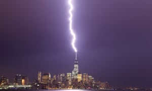 Lightning hits One World Trade Center in Lower Manhattan during an evening storm in New York