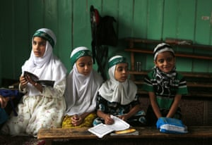 Kashmiri Muslim children attend a class where they learn verses of the Koran