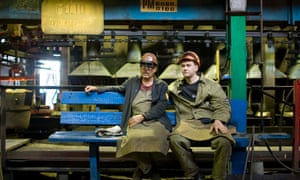 Workers rest as they work in a foundry of Minsk Automobile Factory in 2009.