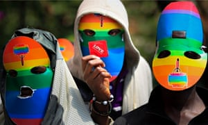 Masked LGBT supporters in Kenya protest against Uganda's anti-gay laws