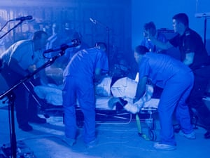 Jack White being wheeled away on a stretcher at the end of the performance