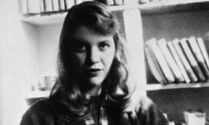 Author Sylvia Plath seated in front of a bookshelf