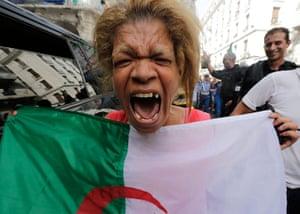 sport: An Algerian soccer fan reacts