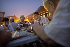Breaking the fast: Chinese Muslims of the Hui ethnic minority enjoy their daily meal at the historic Niujie Mosque in Beijing.