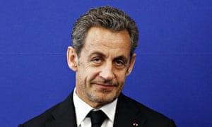 Nicolas Sarkozy with a wry smile, unshaven