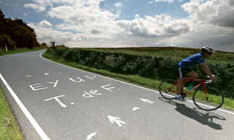 The slogan 'Ey up T. de F.' painted on the road near Sheffield for the Tour de France
