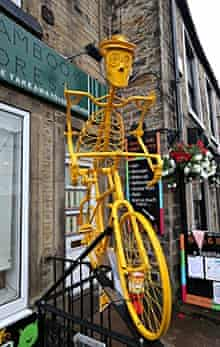 Holmfirth is decorated with yellow bikes as part of the route on stage 2 of the Tour de France