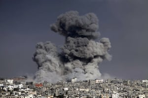 Smoke trails over Gaza city after Israeli shelling.