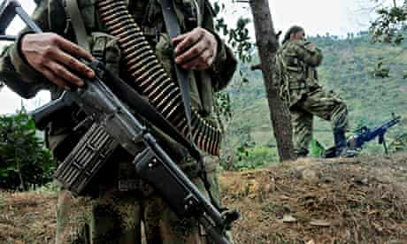 Members of the Farc patrol a road in Cauca province in Colombia