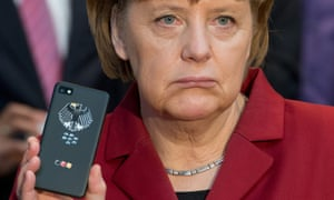 """German Chancellor Angela Merkel with a """"tap-proof"""" Blackberry phone"""