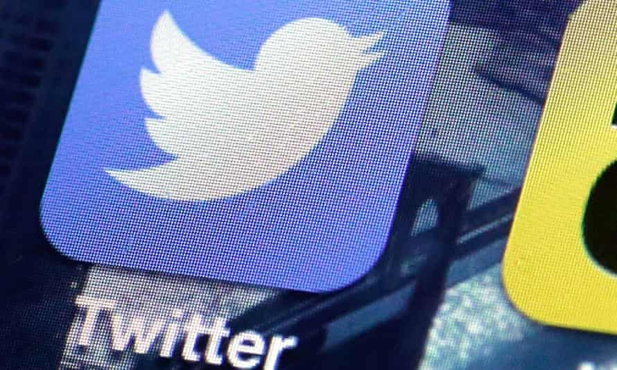 This Friday, Oct. 18, 2013, file photo shows a Twitter app on an iPhone screen, in New York. Twitter reports quarterly financial results on Tuesday, July 29, 2014.