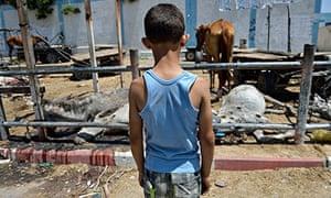 Multiple shells hit a UN school in the northern Gaza Strip refugee camp of Jabaliya