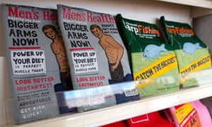 Felt copies of Men's Health and Advanced Carp Fishing on the shelves of a magazine rack.