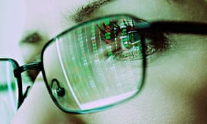 Womans Face with glasses reflecting a computer screen