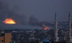 Smoke rises after Israeli shelling in Al Shejaeiya neighbourhood during a military operation in the east of Gaza City, 30 July 2014.