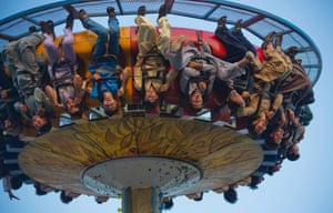 People enjoy a ride during the Eid al-Fitr holiday at a park in Rawalpindi, Pakistan.