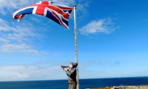 blowing the bugle after raising the union flag at Fort Clonque, Alderney