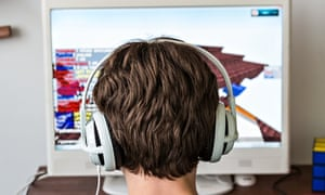 A teenager engrossed in the open-ended virtual world of Minecraft.