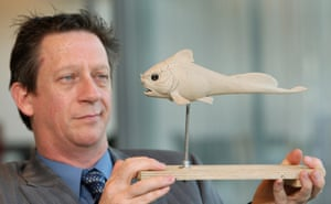 Dr John Long of Museum Victoria in Melbourne holds a model of a placoderm fish fossil that was was found in the Gogo area of north-west Western Australia and was named Materpiscis attenboroughi.