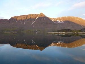 'Midnight sun rising in Kangerluarsk, Disko Fjord, Disko Island, Greenland.'