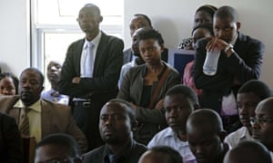 Ugandan activists at the constitutional court in Kampala on 30 July, 2014. They are seeking to overturn tough anti-gay laws.
