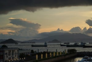 'A thunderstorm ends a fine evening at Victoria Harbour of Hong Kong.'