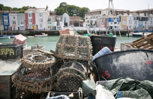 Lobster pots are stacked by the harbour.