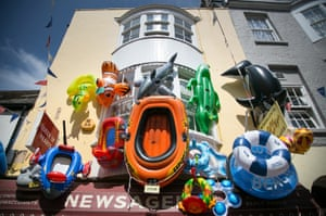 Inflatables are displayed outside a shop