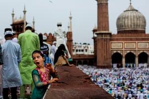 20 photos: A young Indian Muslim yawns during Eid al-Fitr